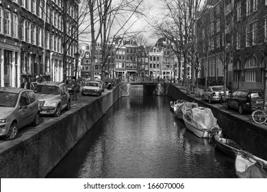 Netherlands, Amsterdam, on April 14, 2012. Typical urban view on canals and their coast. Black-and-white image