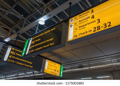 NETHERLANDS - AMSTERDAM - SEPTEMBER 7, 2018: International airport Schiphol with modern arrivals and departures signs in English and Dutch.