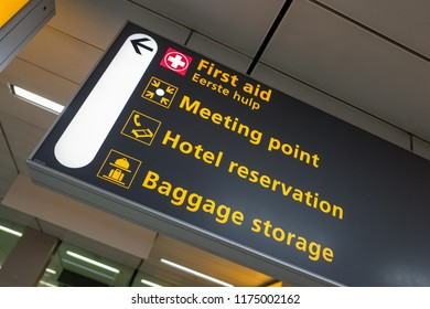 NETHERLANDS - AMSTERDAM - SEPTEMBER 7, 2018: International airport Schiphol with a signboard to first aid in English and Dutch.