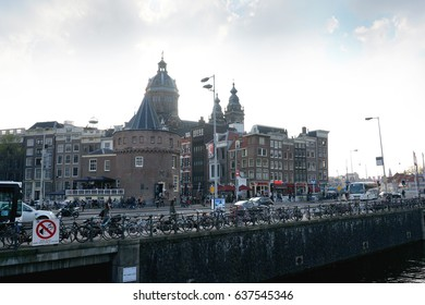 Netherlands, Amsterdam, towns and rivers, April 2016, people are walking through Amsterdam city