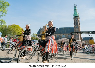Netherlands, APR 21: Band dress up and ride bicycle performancing music in the beautiful and colorful flower parade on APR 21, 2018 at Netherlands