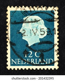 NETHERLANDS - CIRCA 1950: Blue color postage stamp printed in Netherlands with image of Queen Juliana Wilhelmina head.