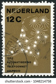 NETHERLANDS - CIRCA 1962: post stamp printed in Nederland shows map showing telephone network; completion of automation of Netherlands telephone network; Scott 392 A93 12c brown, circa 1962
