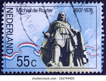 THE NETHERLANDS - CIRCA 1976: A stamp printed in Netherlands shows statue ofAdmiral Michiel Adrianszoon De Ruyter over the sea in Flushing, circa 1976