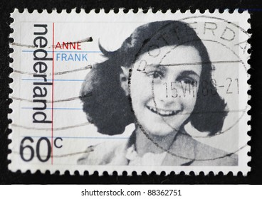 """THE NETHERLANDS - CIRCA 1980: A stamp printed in The Netherlands shows image of Anne Frank with the inscription """"Anne Frank"""", series, issued circa 1980"""
