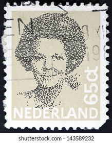 NETHERLANDS - CIRCA 1982: A stamp printed in Netherlands shows portrait of Queen Beatrix regnant of the Kingdom of the Netherlands, circa 1982