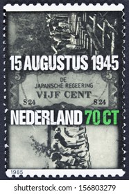 NETHERLANDS - CIRCA 1985: Dutch women in Japanese prison camp, Japnese occupation currency, building of the Burma Railway, circa 1985.