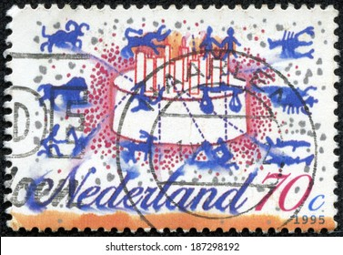 NETHERLANDS - CIRCA 1995: a stamp printed in the Netherlands shows Signs of the Zodiac, Birthday Cake, circa 1995