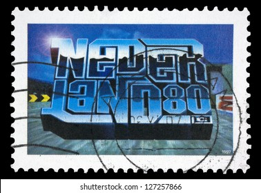 """NETHERLANDS - CIRCA 1997: A stamp printed in Netherlands shows inscription """"NEDERLAND80"""" in style of three-dimensional computer games, from the series """"Youth"""", circa 1997"""