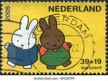 NETHERLANDS - CIRCA 2005: A stamp printed in the Netherlands, shows Miffy the Bunny, by Dick Bruna, White and brown bunnies, circa 2005