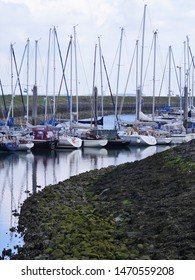 Netherlands , Colijnsplaat, May 9th 2019 11 o' clock and 31 minutes .Recreational port on the river Osterschelde, the port mainly occupied by sailing yachts, overview of the terrain, jetties,