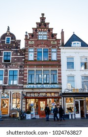 Netherlands, Delft, 13 February 2018 - People Walking in Front of Stores in Delft