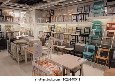 NETHERLANDS - DELFT - JANUARI 28, 2018: Interior of the Ikea store in Delft in The Netherlands, showing chairs and tables department.