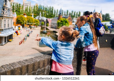 Netherlands. Den Haag. Miniature park Madurodam.July 2016. Little girl to point with a finger to your sister something. in Madurodam park open air museum.