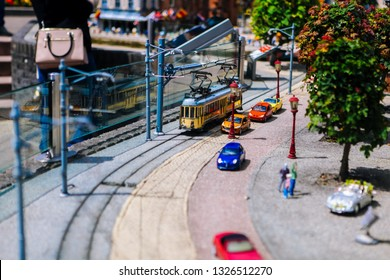 Netherlands. Den Haag. Miniature park Madurodam.July 2016. Old tram in the street. Mini human figures, cars, buildings, trains. in Madurodam park open air museum The Hague. Selective focus