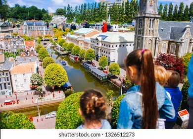 Netherlands. Den Haag. Miniature park Madurodam.July 2016. Girls look at the water and the city in miniature in Madurodam park open air museum The Hague. Selective focus