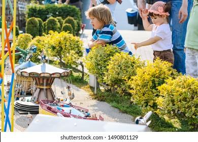Netherlands. Den Haag. Miniature park Madurodam. August 2010. Little girl to point with a finger something in Madurodam park open air museum.