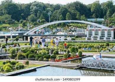 Netherlands. Den Haag. Scheveningen. Miniature park Madurodam. August 2010. Visitors enjoying the replicas of famous dutch buildings as a tourist attraction in Madurodam park open air museum