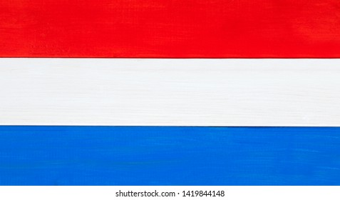 Netherlands or Dutch tricolor flag background - Holland national banner, made from natural wood and paint.