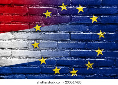 Netherlands and European Union Flag painted on brick wall