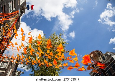 The Netherlands flag and decorations on King's day in Amsterdam