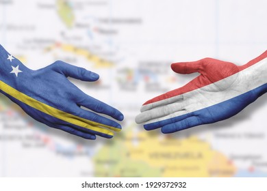 Curaçao and the Netherlands - Flag handshake symbolizing partnership and cooperation with Curacao