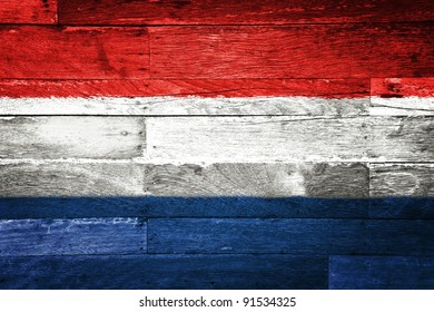 netherlands flag painted on old wood background