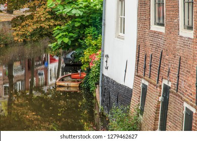 Netherlands, Holland, Utrecht Province, Amersfoort. Medieval old town. Inner city canals. Wooden boat.
