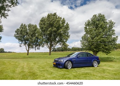 Netherlands June 17, 2016 BMW e46 M3 coupe on a green field at Holland