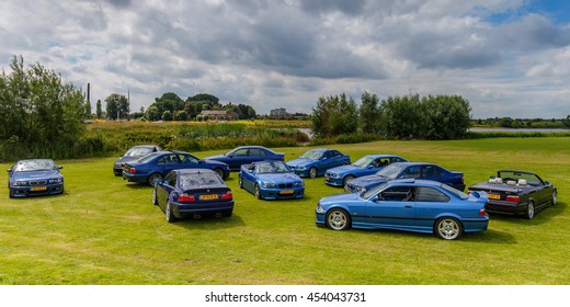 Netherlands June 17, 2016 Group of BMW M3 and M5 series together on a green field on a sunny day