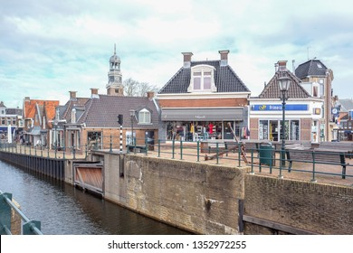 NETHERLANDS - LEMMER - MARCH 8, 2019: Sluice and buildings in the center of Lemmer in in Friesland, Netherlands.