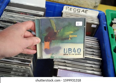 THE NETHERLANDS - MARCH 16, 2018: CD album: UB40 - Guns in the Ghetto. CD record by UB40 an English reggae and pop band, in a second hand store.