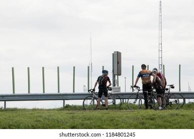 Netherlands, North-Holland,Den-Oever,july 2018:Bikers rest before their 30 kilometer trip over the Afsluitdijk