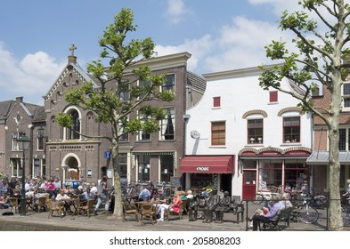 NETHERLANDS - OUDEWATER  - CIRCA JUNE -2014: People on a terrace in the center of the village Oudewater.
