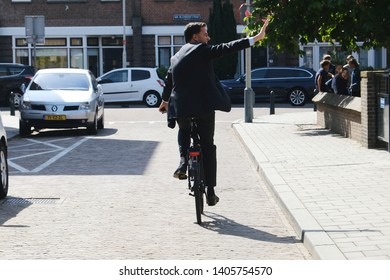 Netherlands Prime Minister Mark Rutte leaves a polling station on bike after voting for the European elections in The Hague, Netherlands on May 23rd, 2019.