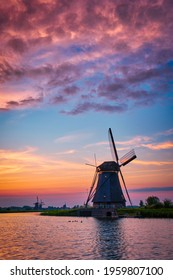 Netherlands rural landscape with windmills at famous tourist site Kinderdijk in Holland on sunset with dramatic sky