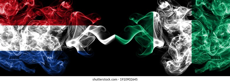 Netherlands vs Nigeria, Nigerian smoky mystic flags placed side by side. Thick colored silky abstract smoke flags.