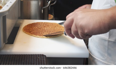 The Netherlands waffle, stroopwafels or Dutch waffles with caramel. Cooking process of Dutch waffles.