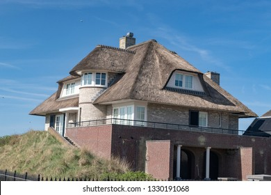Netherlands, zeeburg, 2017, An stunning example of a thatched roof on a red bricked house looking out over the north sea.
