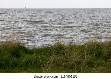 Netherlands,Friesland,Afsluitdijk, The IJsselmeer dark and windy