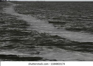Netherlands,Friesland,Afsluitdijk, The IJsselmeer dark and windy