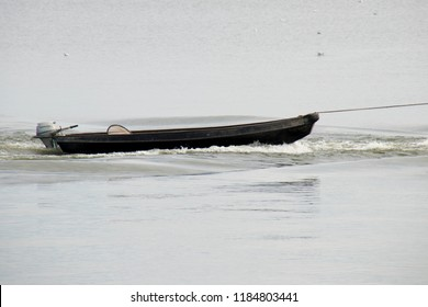 Netherlands,Friesland,Afsluitdijk, july 2018:Fishing boattowing  the towing a workboat with a rope