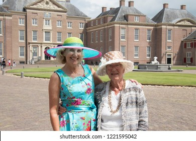Netherlands,Gelderland,Apeldoorn,crown land,august 2017: a group of elderly women visiting the crown land Loo  showing their selfmade  hats