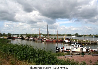 Netherlands,Holland,Dutch,North Brabant, Woudrichem, may,2016:Boats mooring on the quay of the embanked river Maas
