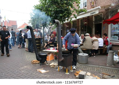 Netherlands,Holland,Dutch,North Brabant, Woudrichem, may,2016:People dressed up at annual fair in the streets of Woudrichem