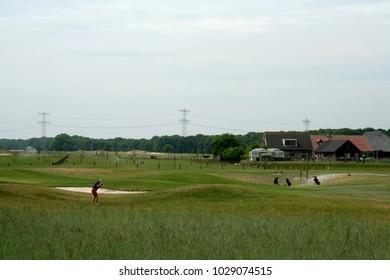 Netherlands,Noord Brabant,Breda,Teteringen, june 2016:Golfers playing on the Golf-yard in Teteringen