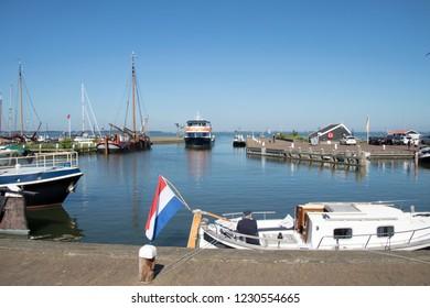 Netherlands,North,Holland,Marken,august 2018:Ferry from Volendam enters the harbour of Marken