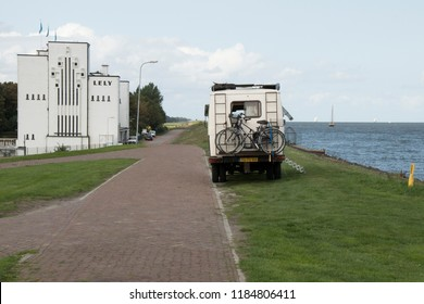 Netherlands,North-Holland,Medemblik,july 2018:Camper parked on the Zuiderdijk near the Pumping station Lely in Medemblik
