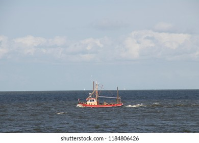 Netherlands,North-Holland,Medemblik,july 2018:Fishing boat at work on the IJsselmeer