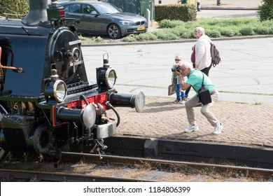 Netherlands,North-Holland,Medemblik,july 2018:Man is photographing historic train